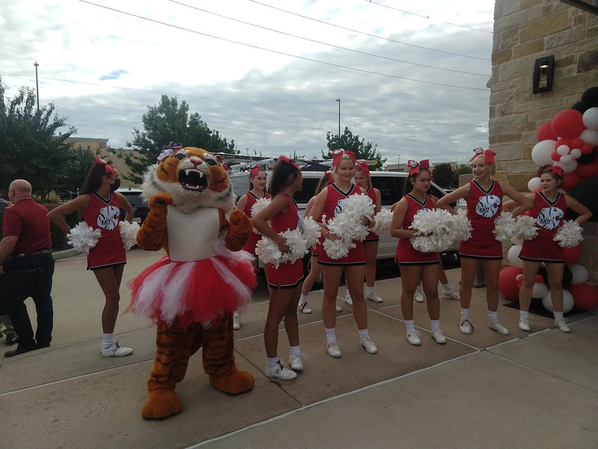 The Katy Tiger cheer squad jazzes up the crowd at the ribbon cutting for Old Chicago Pizza & Taproom on Oct. 11. The ceremony was just one part of SPB Hospitality's big news for the Katy area after it opted to move its corporate office from Denver, Col. to Texas which will bring hundreds of jobs to the community.