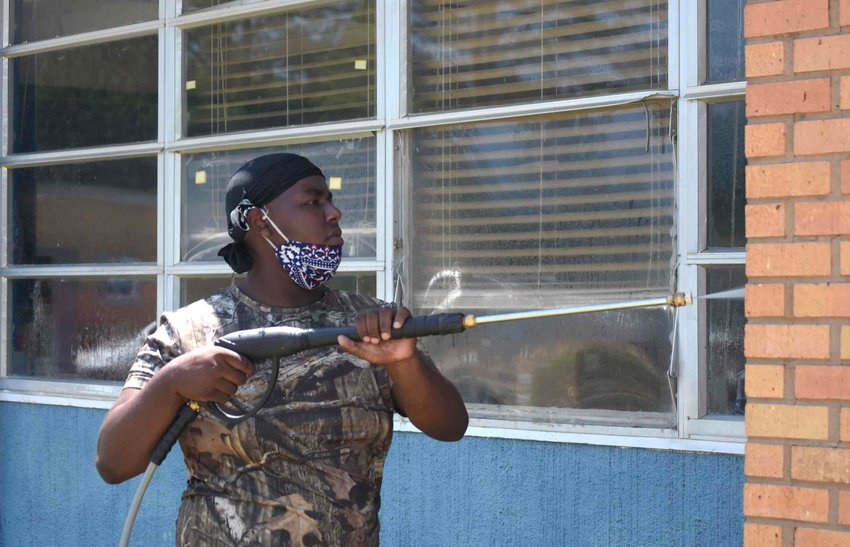 Work is ongoing to have the Kemper County schools clean and ready to go when   students return to their classes in August. These Kemper County students have been employed as summer workers to wash down the buildings and do other work.    Submitted   photos