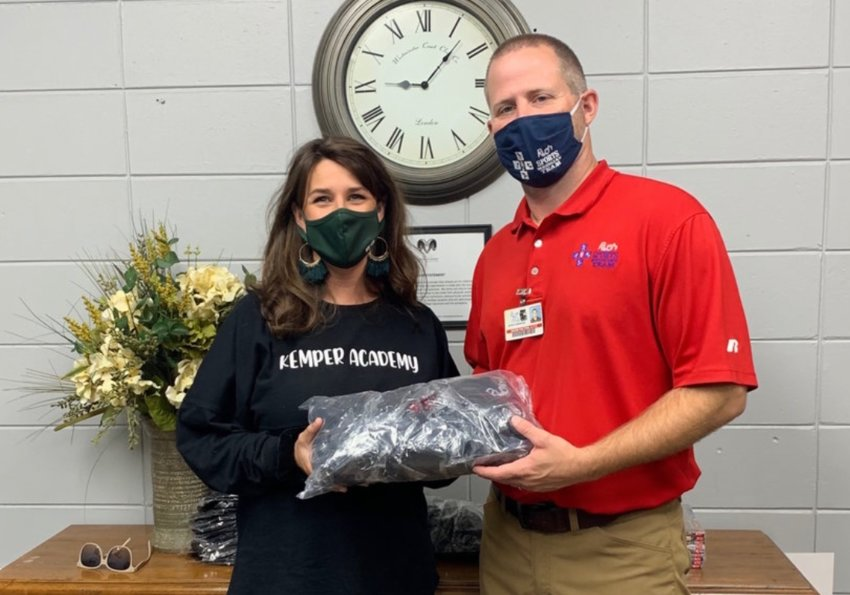 Kemper Academy Photo – Pictured (left to right): Mary Ellen Waters, Headmaster and Davis Fulton, Athletic Trainer with the Rush Sports Medicine Team