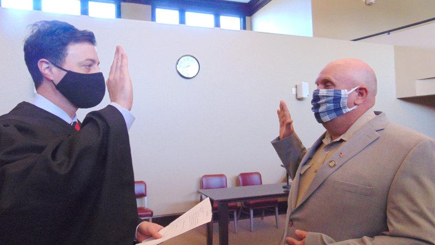Judge Joseph Kilgore swears in Terry Bostick as coroner of Kemper County.