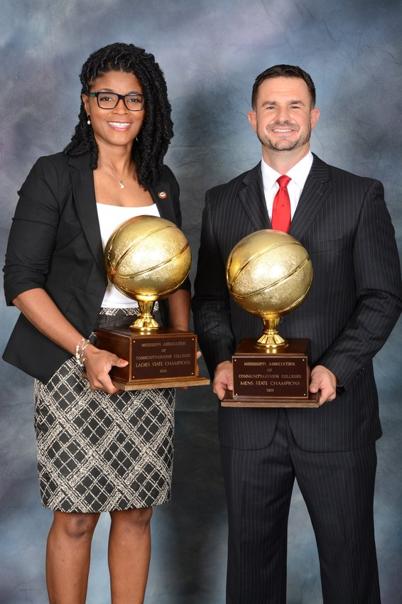 East Mississippi women's basketball coach Sharon Thompson holds the state championship trophy her team won last season, while men's coach Billy Begley holds the 2019 championship trophy the Lions captured. The East Mississippi teams are preparing to get their season under way.