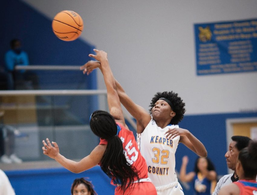 aTy'Asia  Bohannon (32) takes a shot for the Kemper County Lady Wildcats in an earlier game. The Lady Wildcats defeated West Marion 49-21 Monday night in the first round of the playoffs.
