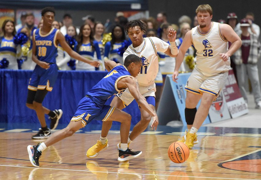 Kemper County's Alfred Love (5) drives against Booneville's L.J. Shumpert at the MHSAA State Basketball Tournament  semifinals on Wednesday, March 3, 2021, at the Mississippi Coliseum in Jackson, Miss.