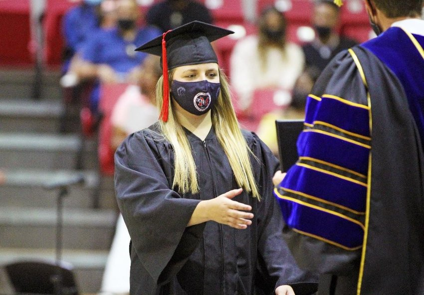 Preston resident Anna Cumberland receives her diploma during a May 8 graduation ceremony on East Mississippi Community College's Scooba campus.