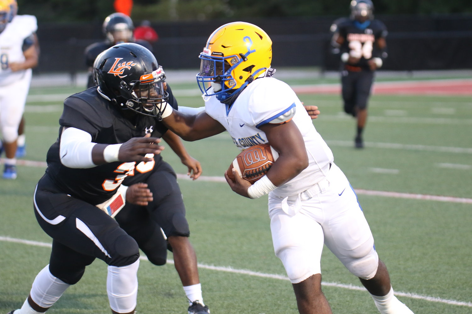 Dicenzo Miller (2) uses a stiff arm in the Wildcats scrimmage earlier this season.