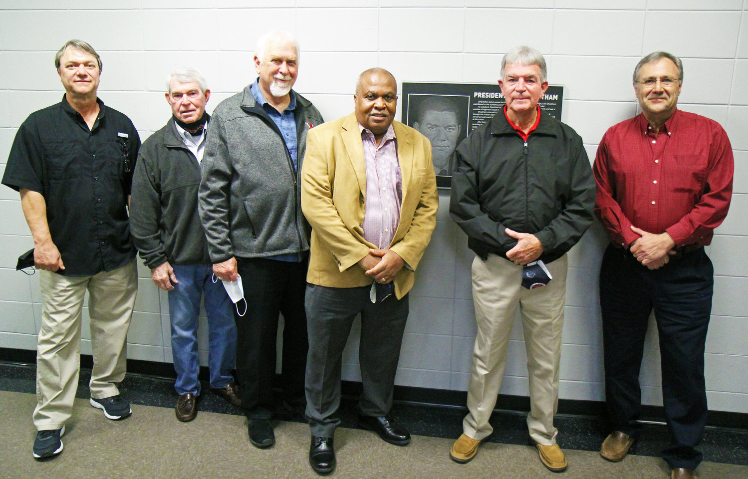 Sons Chris Cheatham (far left) and Brad Cheatham (far right) pose with EMCC Board of Trustees members on EMCC's Scooba campus Monday night after a plaque dedication honoring their father, former EMCC President Clois Cheatham. Board members pictured, from left, include Bubba Davis, Jimmie Moore, Ed Mosley and Bobby McDade.