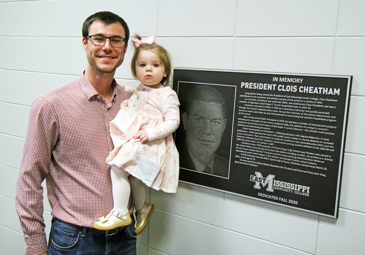 Daniel Cheatham and daughter, Roma Jane Cheatham, take a photo with a plaque honoring their grandfather and great-grandfather, former EMCC President Clois Cheatham, after a ceremony Monday night on EMCC's Scooba campus. The plaque was unveiled in a dedication of the Science wing of Oktibbeha Hall.