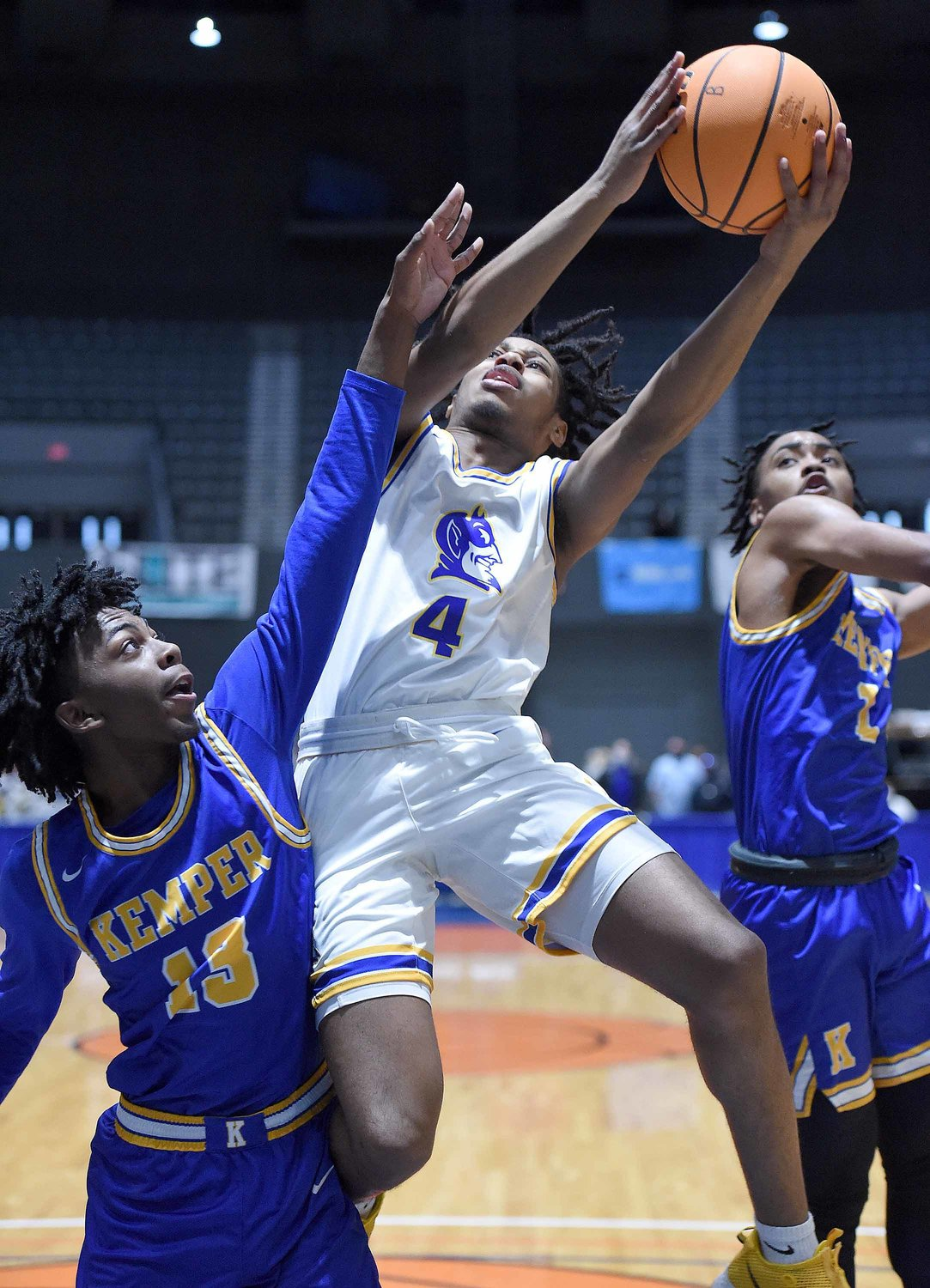 Kemper County's Aiden Bourrage (13) defends against Booneville's Dicorean McGee (4) at the MHSAA State Basketball Tournament  semifinals on Wednesday, March 3, 2021, at the Mississippi Coliseum in Jackson, Miss.