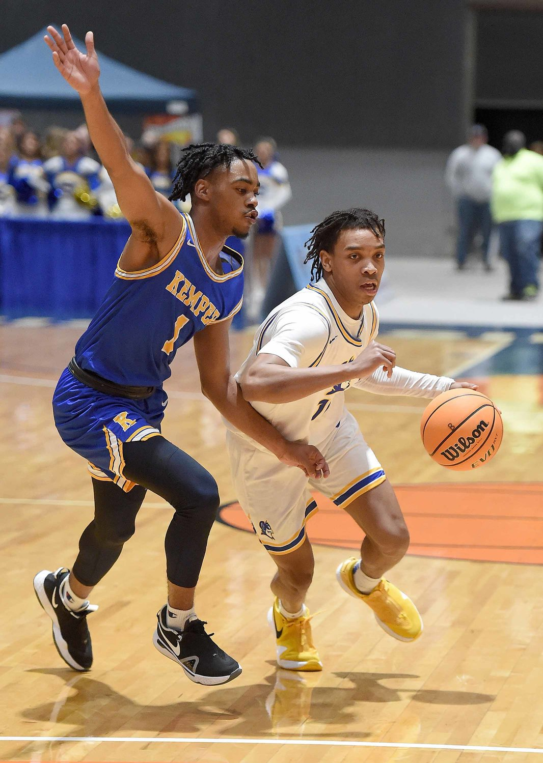 Kemper County's James Granger (1) defends against Booneville's L.J. Shumpert at the MHSAA State Basketball Tournament  semifinals on Wednesday, March 3, 2021, at the Mississippi Coliseum in Jackson, Miss.
