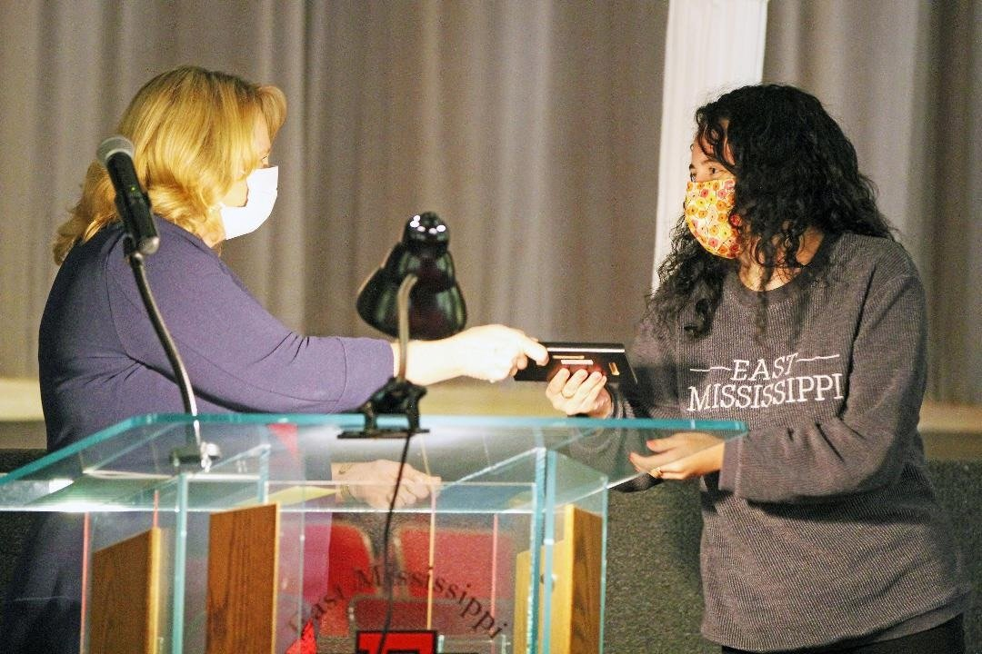 East Mississippi Community College Psychology instructor Louise Mullins, at left, presents Jasmine White of DeKalb with a plaque recognizing her as the Outstanding Child Psychology Student during the April 22 Awards Day on the college's Scooba campus.