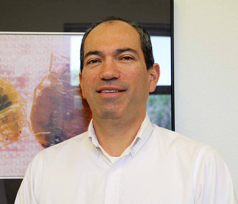 Alvaro Romero, assistant professor of urban entomology in New Mexico State University's Department of Entomology, Plant Pathology and Weed Science, has been researching bed bugs for years. He is the lead author of a report recently published in the Entomological Society of America's Journal of Integrated Pest Management. The report focuses on the importance of prevention rather than reactive-only methods. (Photo by Lucia A. Torres) MAY17