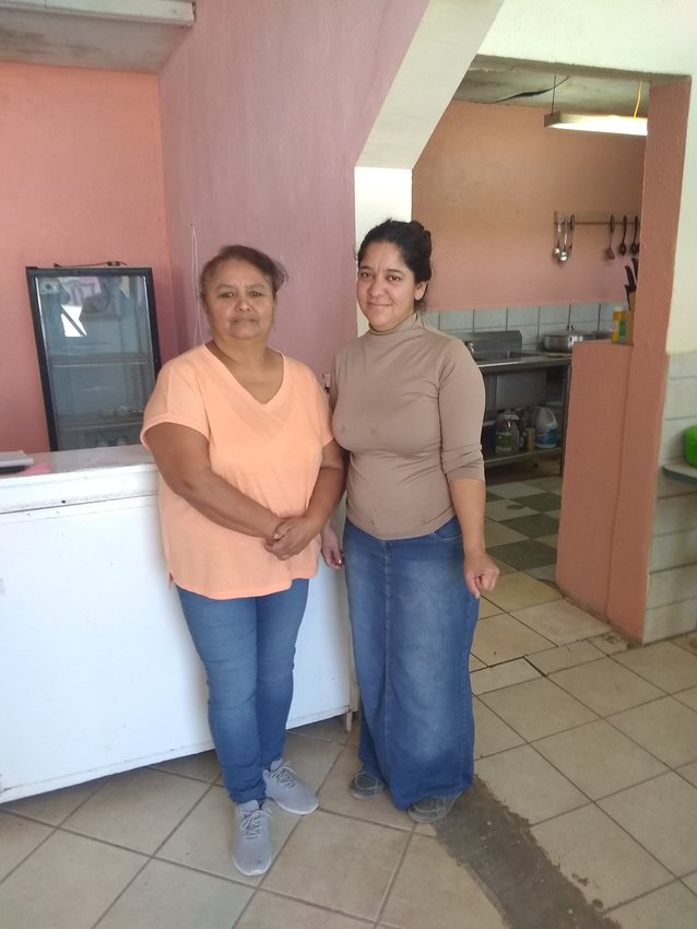 Esperanza Lozoya and Rode Tapia, both working at Luz de Esperanza food bank.