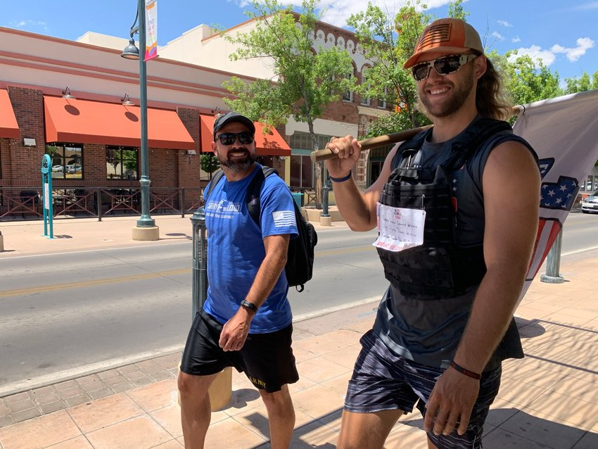 """Rocky Everett and Jason Diggins """"Carry the Load"""" through Downtown Las Cruces as part of the nonprofit effort to recognize veterans and first responders who have lost their lives. The Carry the Load events has four relays that converge in Dallas for Memorial Day. The West Coast Relay, which came through Las Cruces May 18, started in Seattle."""