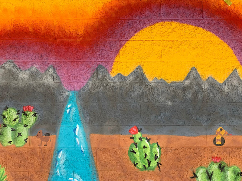 """The future Organ Mountain High School (currently Oñate High School) students Tahlor Triolo and Sarahi Alvarado, painted the """"Preserve Wildlife"""" mural. Four student created murals at the school entrance were unveiled as part of the rebranding of the school's name. The name change is official on July 1."""