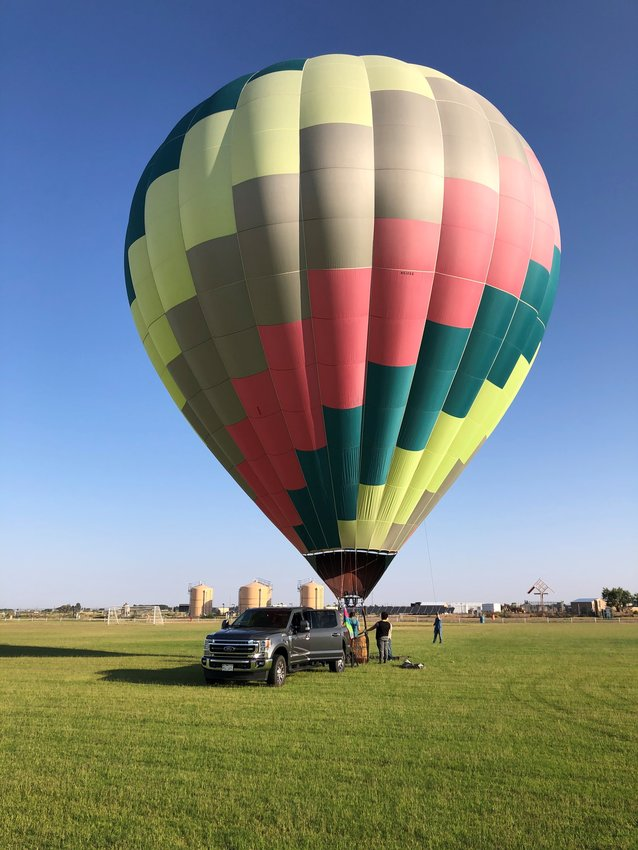 """The """"Flicker"""" hot air balloon, piloted by David Chelgren Jr., will participate in the 9.11 commemorative balloon glow on the grounds of the New Mexico Museum of Space History Saturday evening, September 11, beginning at approximately 7:45 pm. The event is not open to the public but will be visible throughout the community"""