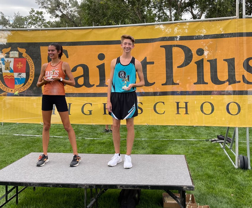 Organ Mountain High School's Jeron Wisner was the winner of the Number 3 boys race at the Super Cinco Invitational in Albuquerque. He is pictured with the girls Number 3 winner, Isadora Miller of Eldorado High School.