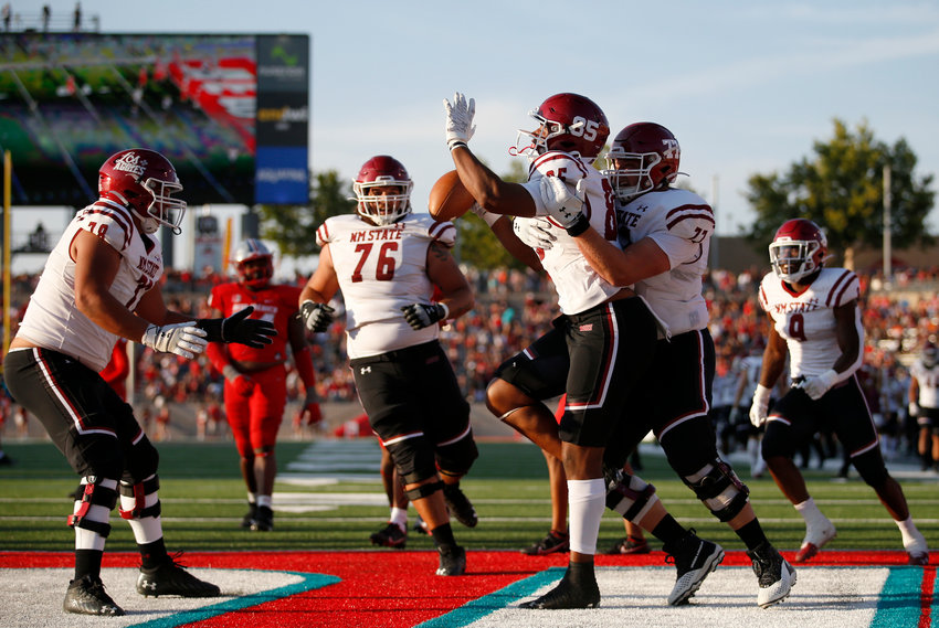 New Mexico State University celebrates a touchdown against archrival University of New Mexico on Sept. 11 in Albuquerque.