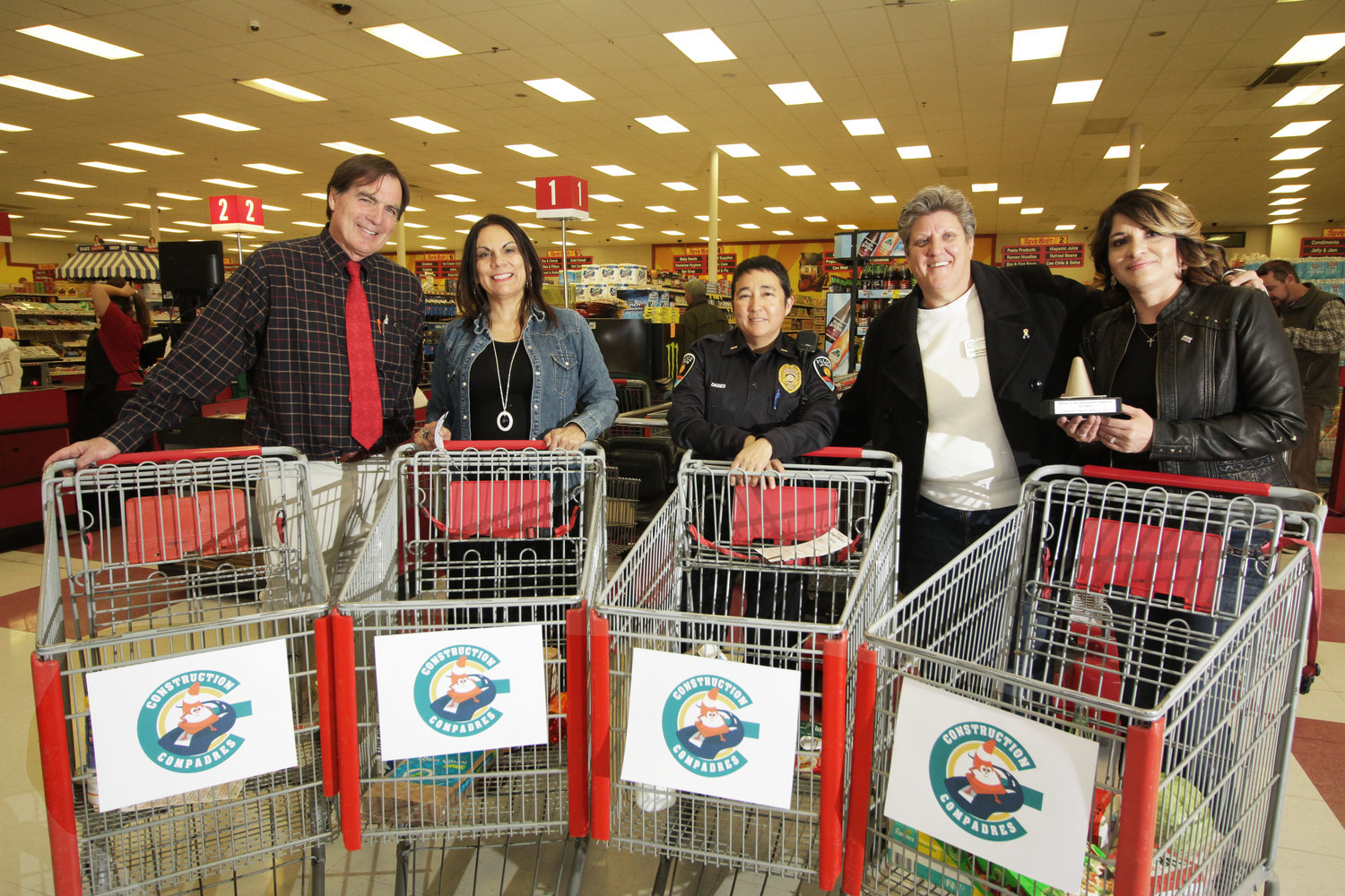 Participants in the Supermarket Sweep Feb. 21 at Save Mart were, from left, City Councilors Greg Smith and Kasandra Gandara, Las Cruces Police Department Lieutenant Kiri Daines, Green Chamber CEO/President Carrie Hamblen, and the Supermarket Sweep winner, JoAnn Garay, director of the Small Business Development Center.  (Bulletin photo by Steve MacIntyre)