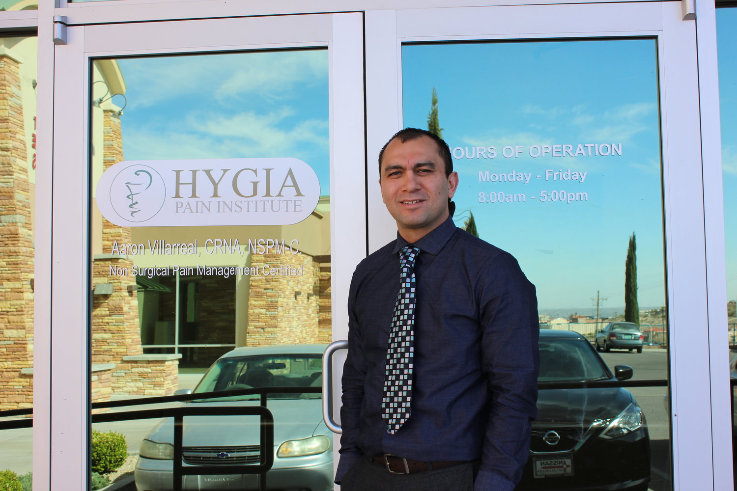 Certified registered nurse and anesthetist Aaron Villarreal stands outside the front doors of Hygia Pain Institute, 3851 E. Lohman Ave., Ste. 4, which opened on April 1. (Photo by Alexia Severson)