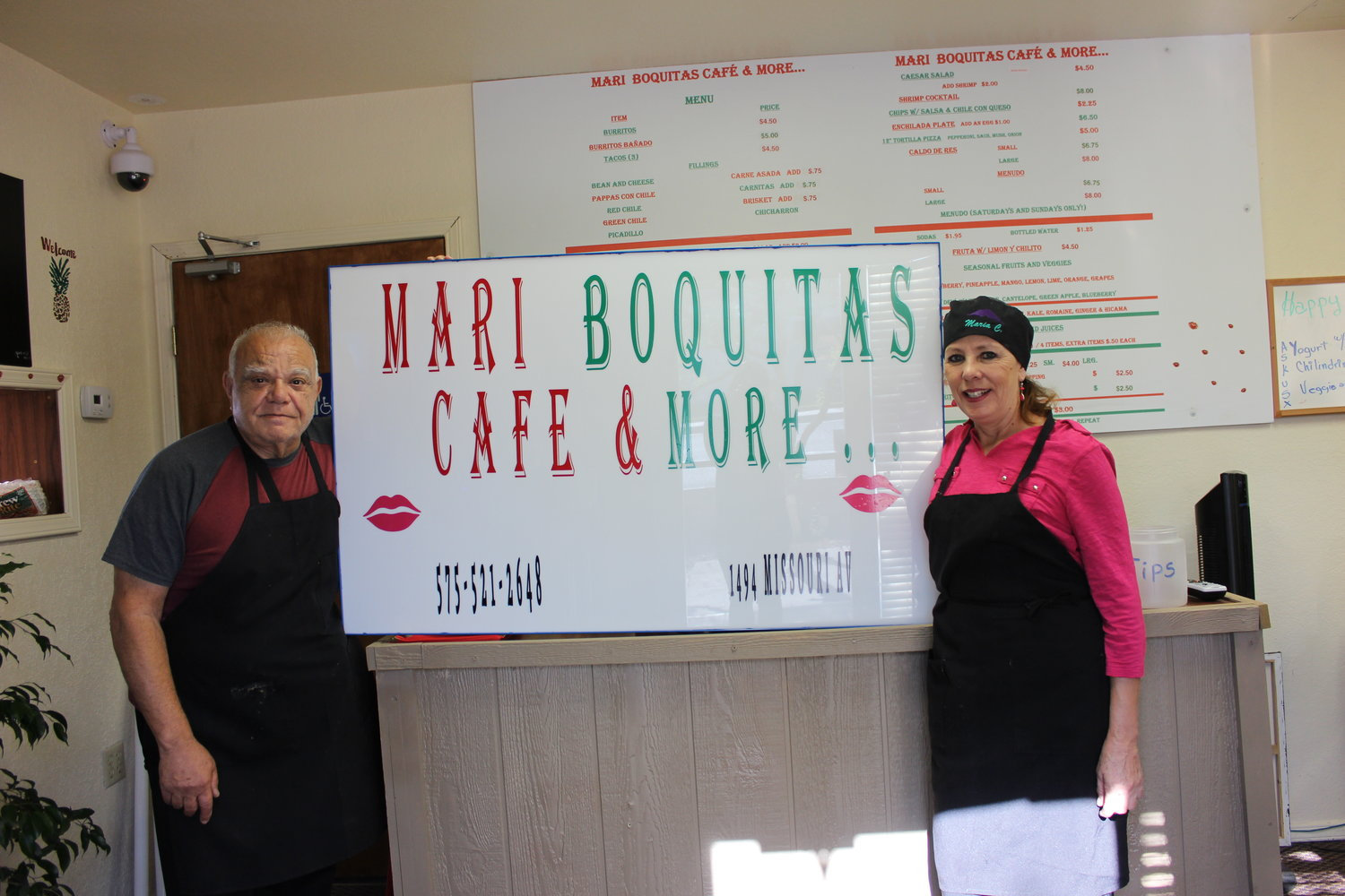Michael Vento and Maria Chavez Vento stand next to a sign for their new restaurant, Mari Boquitas Café and More, located at 1494 Missouri Ave, in the same building as Baskin Robins.