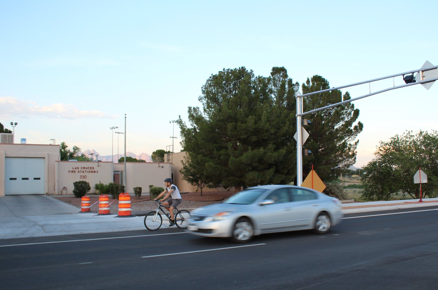 A local cyclist enjoys an evening ride on the completed portion of Valley Drive, outside Las Cruces Fire Station 3. The new road design ensures that drivers and riders have safer paths to travel throughout the city.