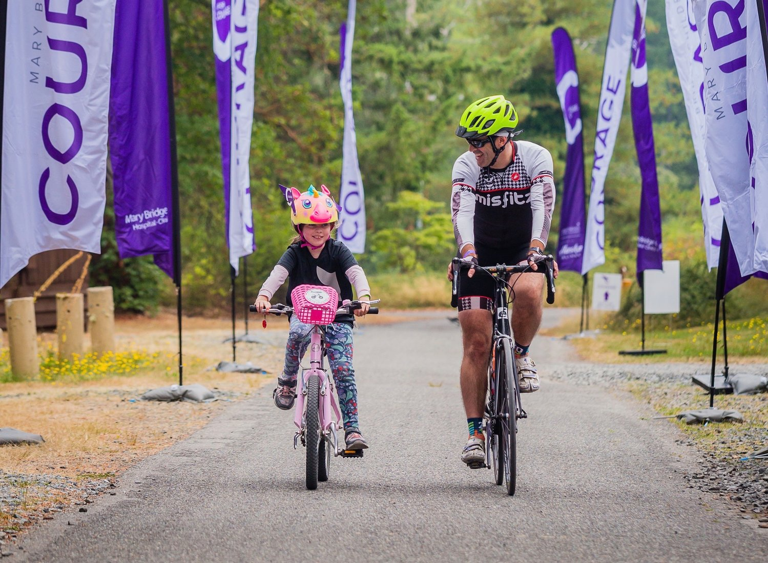 Marc Wright and his daughter Helen ride bikes together near Seattle.