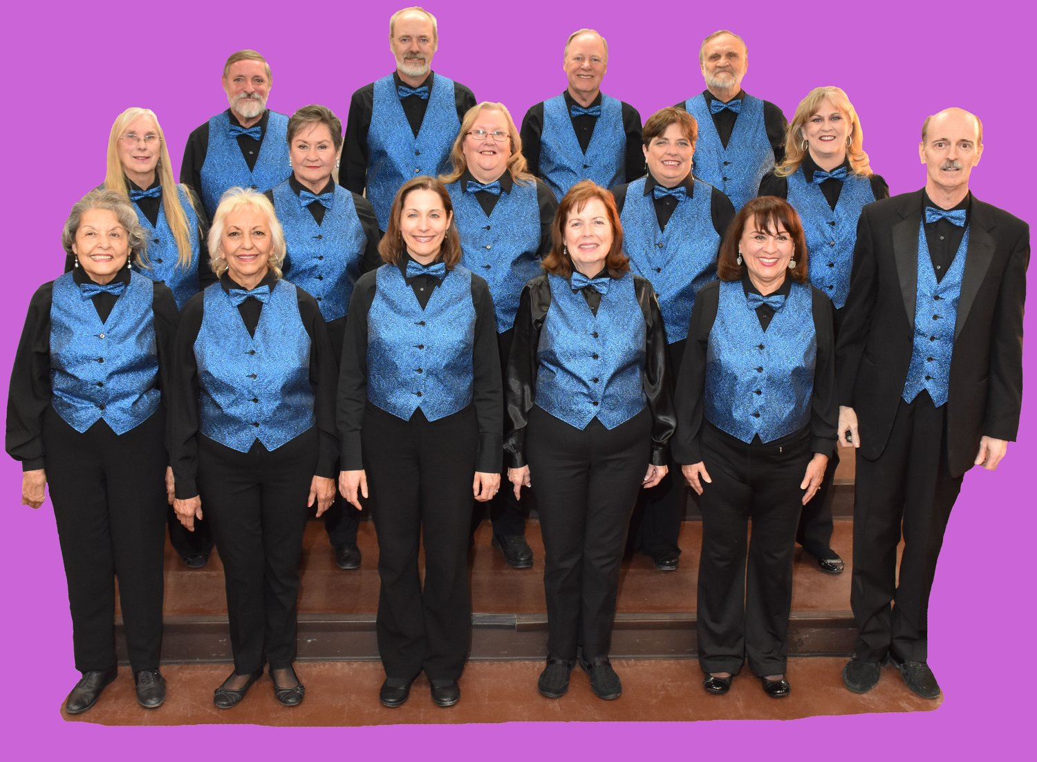 The New Desert Harmony Singers, with Director Don Harlow at far right wearing the suit.