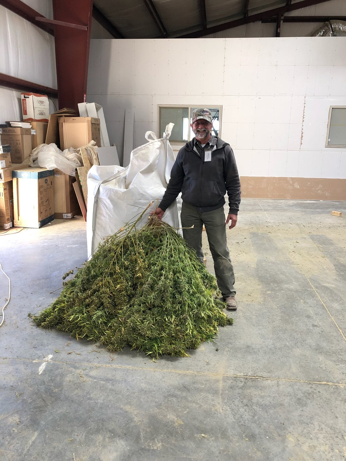Jeff Anderson with a 35-pound hemp plant in Nevada.