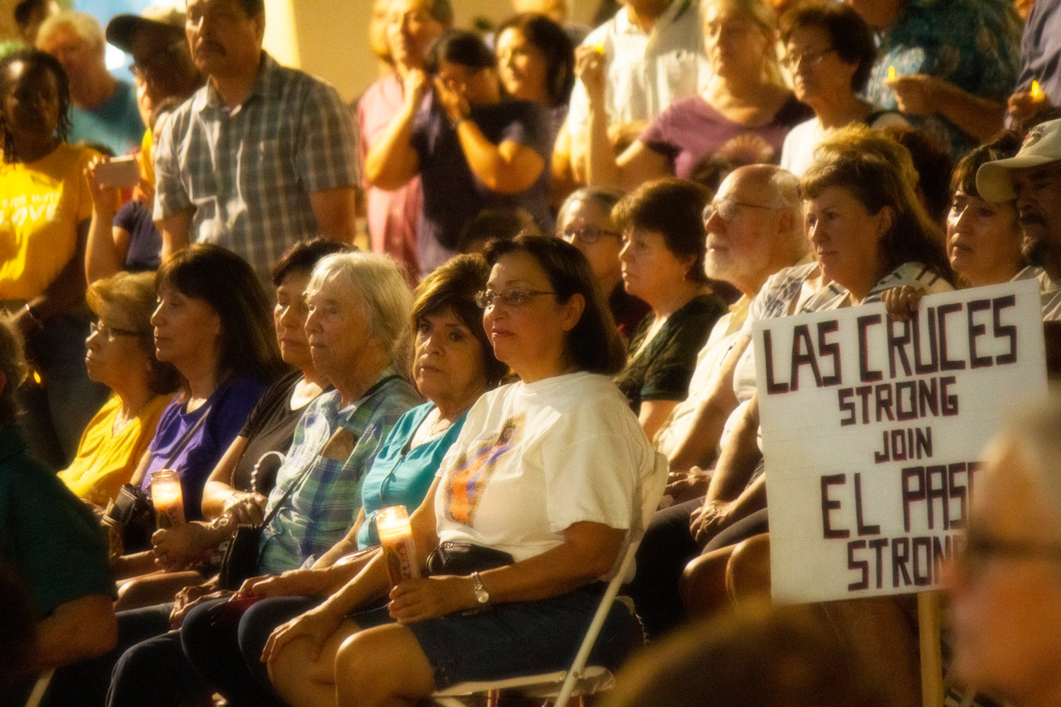 Residents of Dona Ana county came together Monday night on the Plaza de Las Cruces to join in solidarity with the City of El Paso after an act of terrorism Saturday morning at a Walmart in El Paso that has left 22 victims confirmed dead.