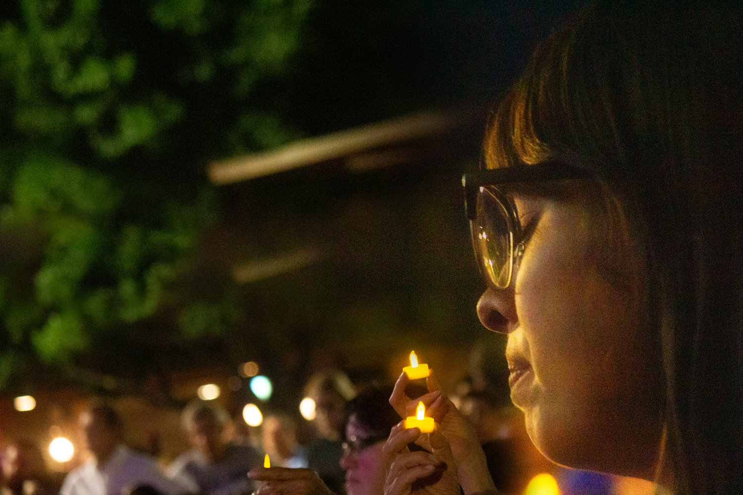 Las Cruces resident Raquel Madrigal reacts to the tragedy that occurred in El Paso Saturday morning during a gathering of solidarity with the City of El Paso Monday night on the Plaza de Las Cruces.
