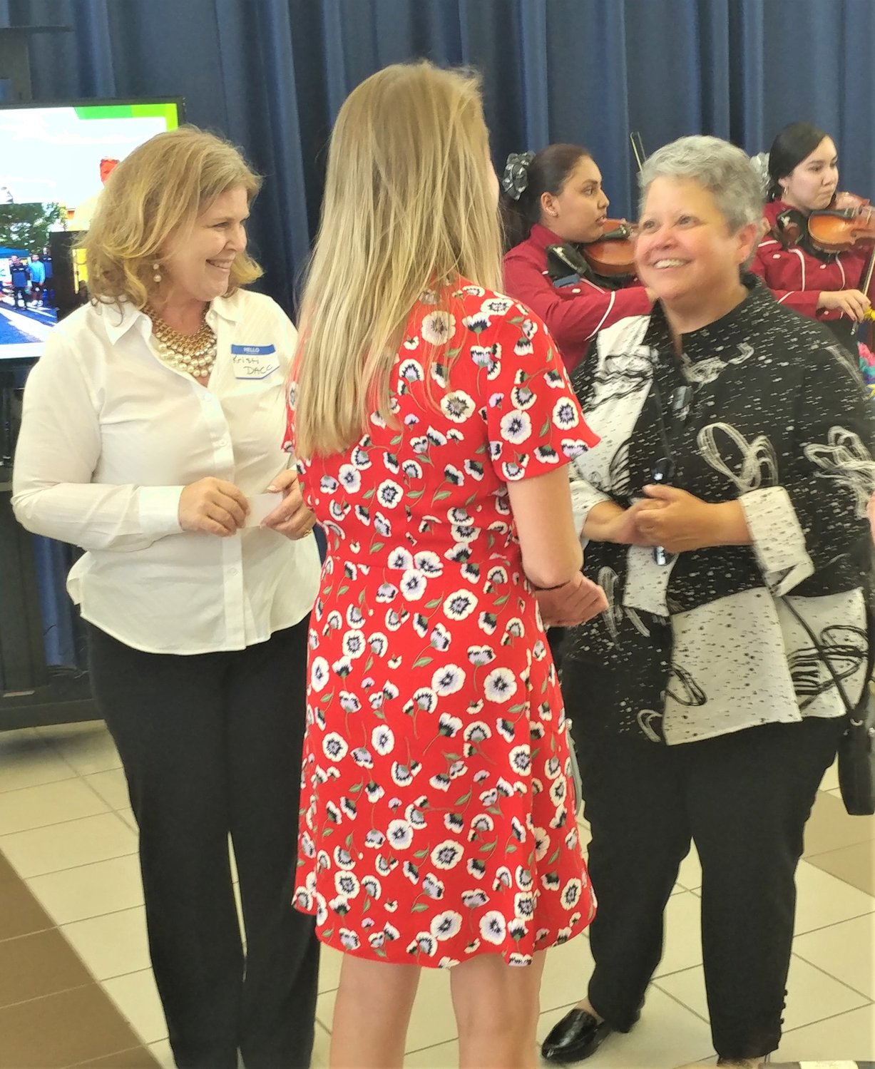 New Doña Ana Community College president Monica Torres talks to attendees at the Aug. 2 reception held in her honor.