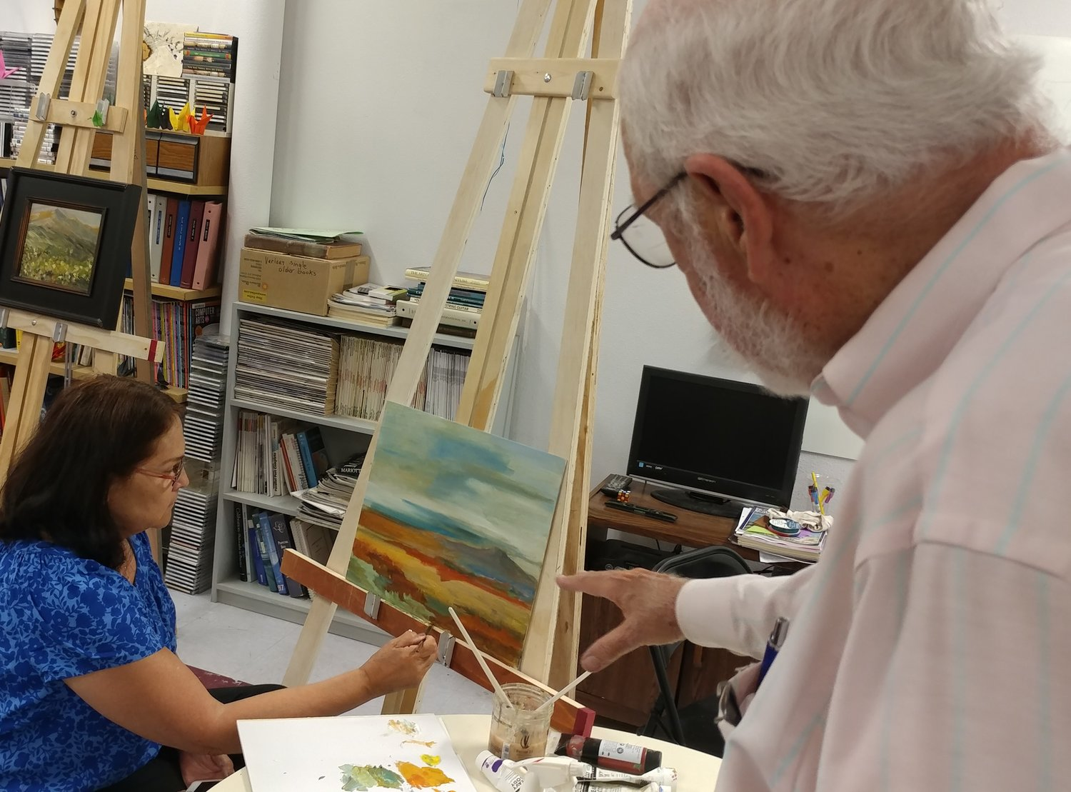 Las Cruces art teacher Wayne Huber with student Maria Lopez.