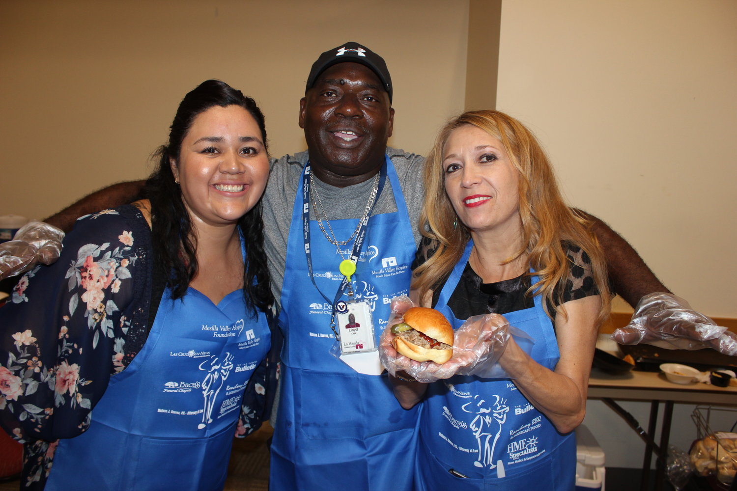 Lloyd Marshall, center, assisted by Maggie Rodriguez and Stella Terrazas, created sliders for Men Who Cook.