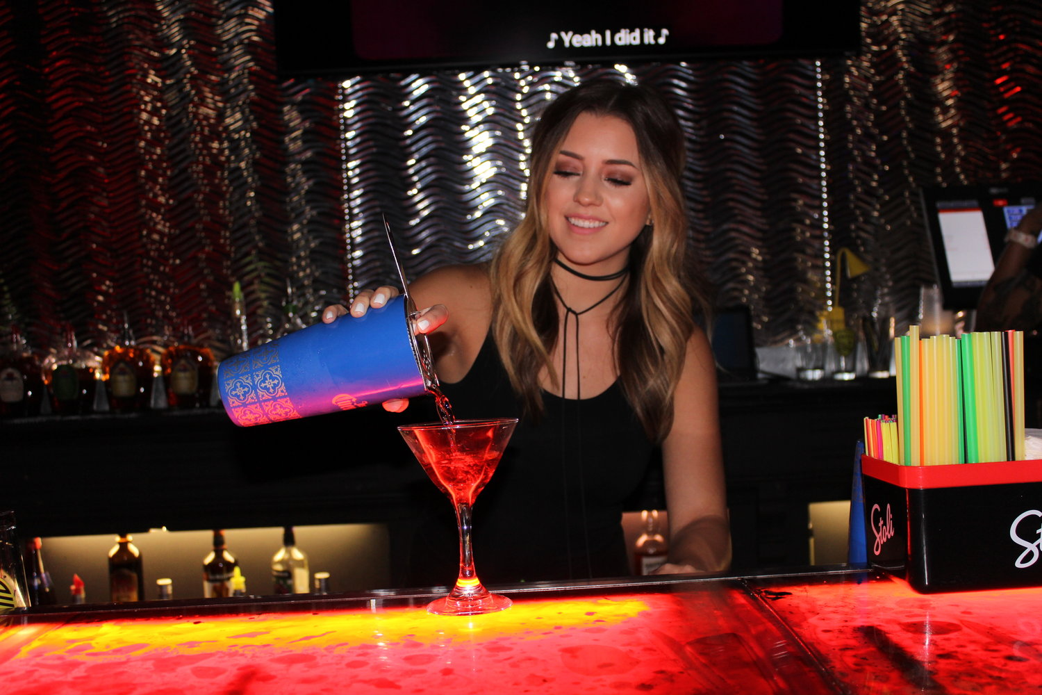 Club 30 bartender Chandler Benda pours a drink on Thursday, Aug. 8, during the club's Happy Hour, which runs from 4 to 8 p.m. every day.