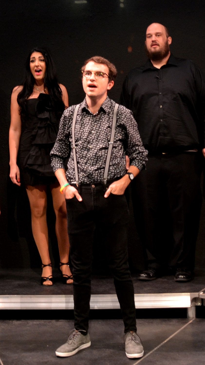 "Gus Sanchez, Joshua Taulbee and Nora Thomas-Medina in Black Box Theatre's recent production of ""The World Goes 'Round."""