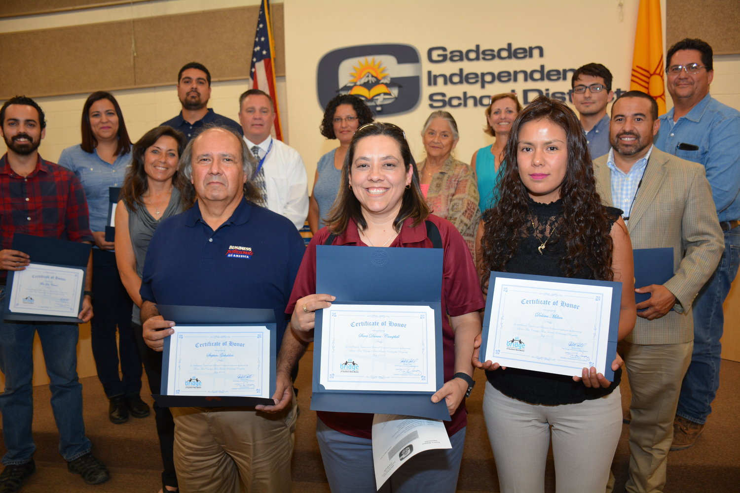 From left, Stephen Gabaldon, Sara Duran-Campbell, and Dolores Millan were honored by members of the GISD school board as the first teacher externs in Doña Ana County. They are joined by representatives from El Paso Electric, Film Las Cruces, Jacobs Technology and The Bridge of Southern New Mexico, who provided the work-based experiences and stipends for the teachers.