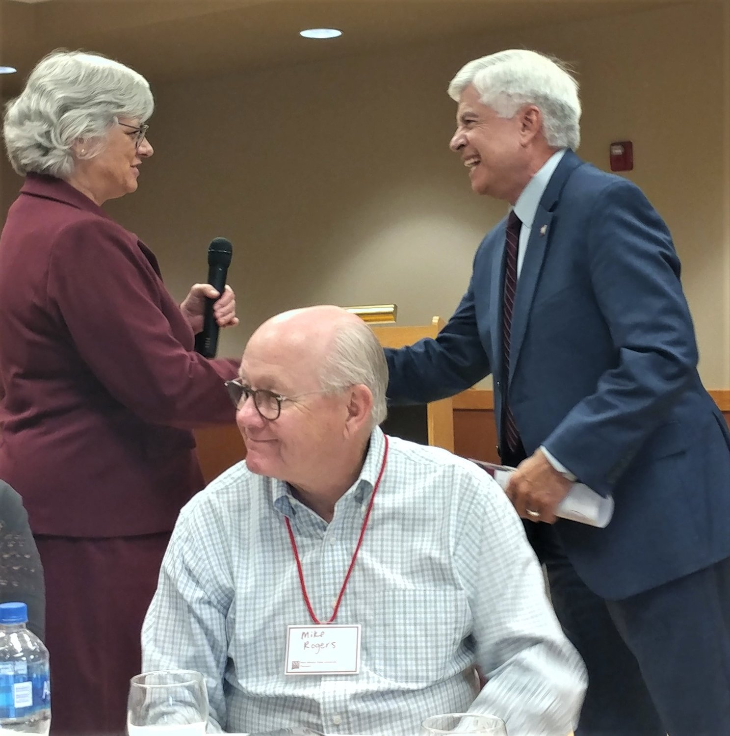 With NMSU Pioneers member Mike Rogers in the foreground, NMSU Chancellor Dan Arvizu greets NMSU's new provost, Carol Parker.