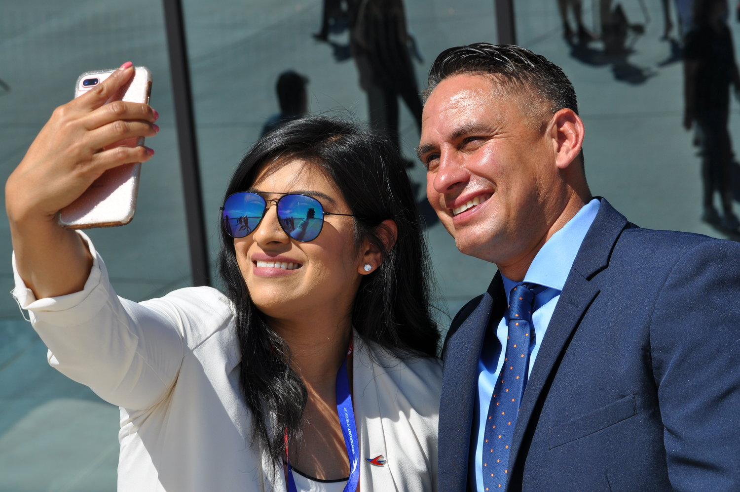 Spaceport America Authority's Rosa Banuelos and New Mexico Lt. Gov. Howie Morales pause for a joint selfie in front of the Gateway to Space Building during the Thursday, Aug. 15 introduction event.