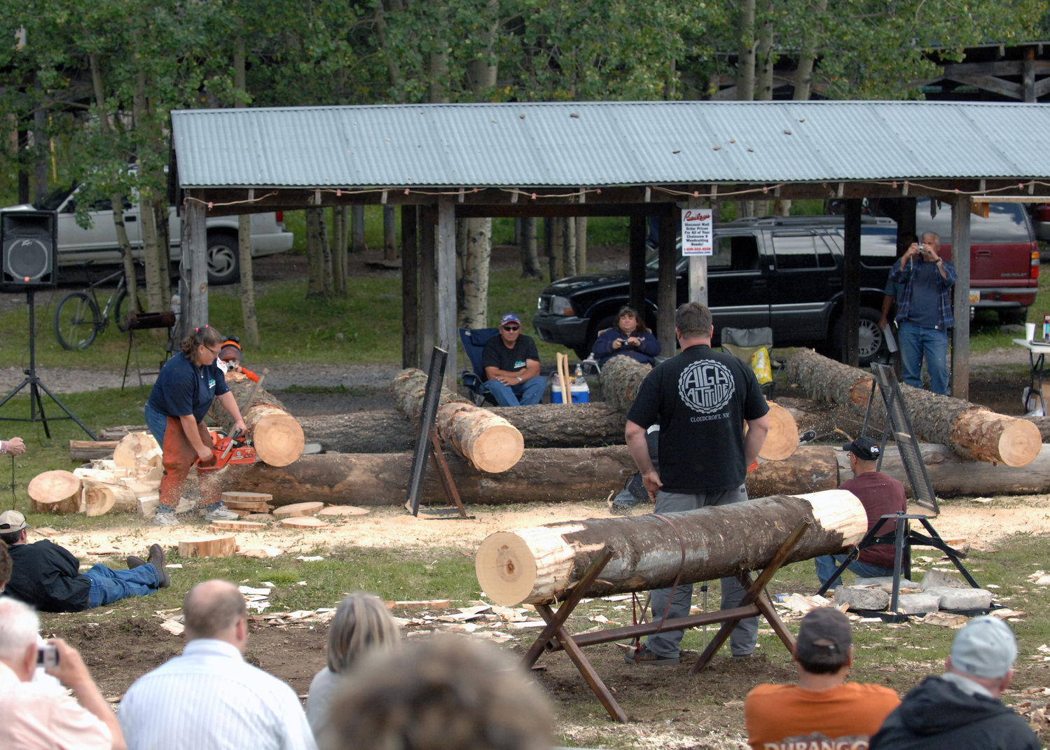 Dana Lenzo, competitor in Lumberjack Day, chops off pieces of pinewood at Zenith park in Cloudcroft, N.M., September 20. Judges and the audience watched as the lumberjack contestants competed in more than 18 events against one another to win first prize. This year Lumberjack Day is celebrated with contests and music Sept. 21.