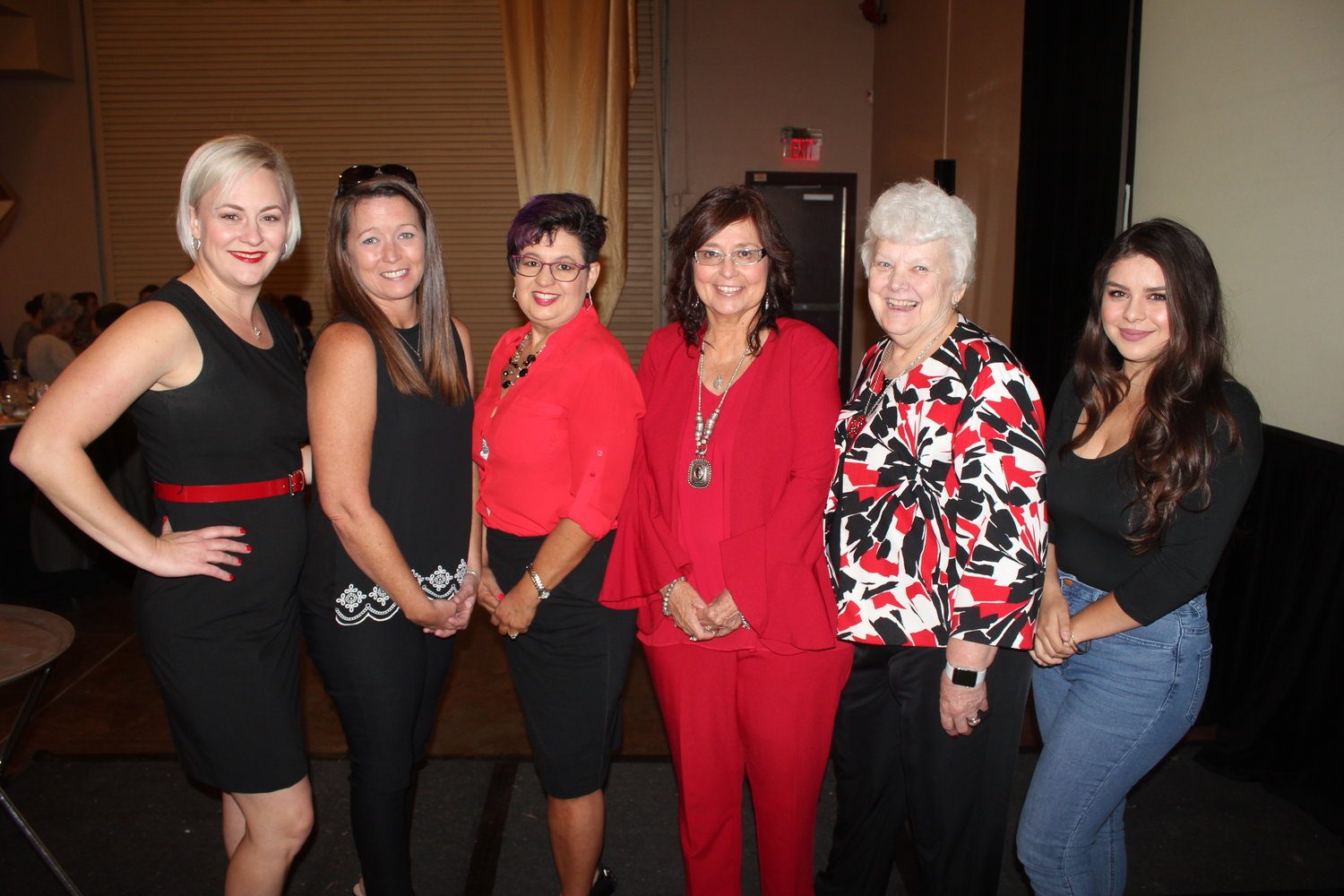 Sumer Rose-Nolen, Jennifer Bales, Jenn Baca, Cindy Torres, Wanda Bowman and Jazmine Rubio are part of Revolution 120, a group recognized by the Girl Scouts of the Desert Southwest with the inaugural Jo Tice Bloom award for its work helping families and groups in crisis. Not pictured is Revolution 120 director Marci Dickerson, who was helping to serve food at the luncheon.