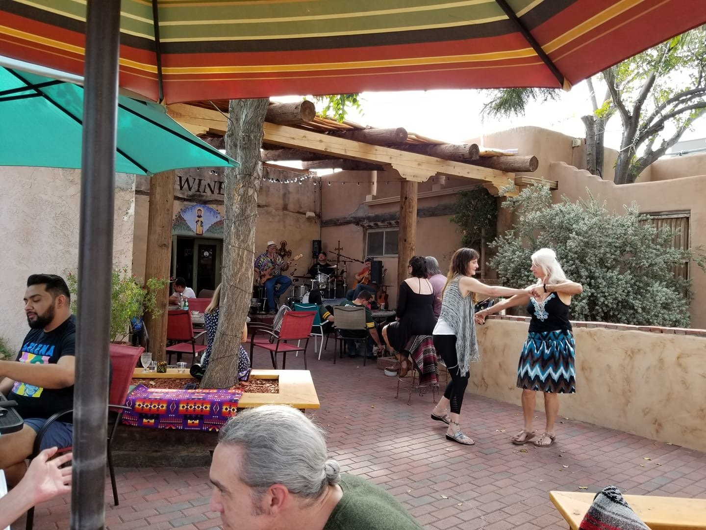 Customers enjoy live music on NM Vintage Wine's new, expanded patio on a Sunday afternoon.