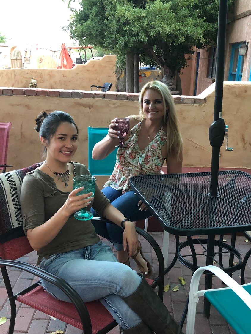 Customers at NM Vintage Wines have a drink on the new patio.