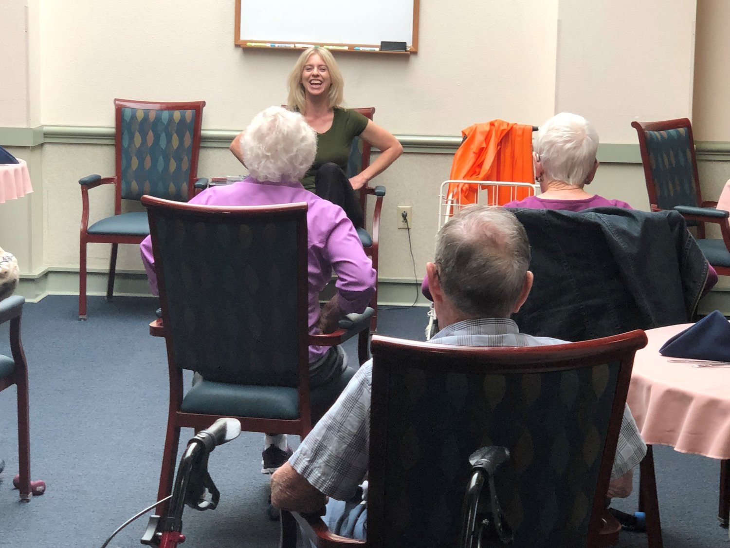 Good Samaritan Well-Being Coordinator Pam Rodgers works with residents to help them stay limber.