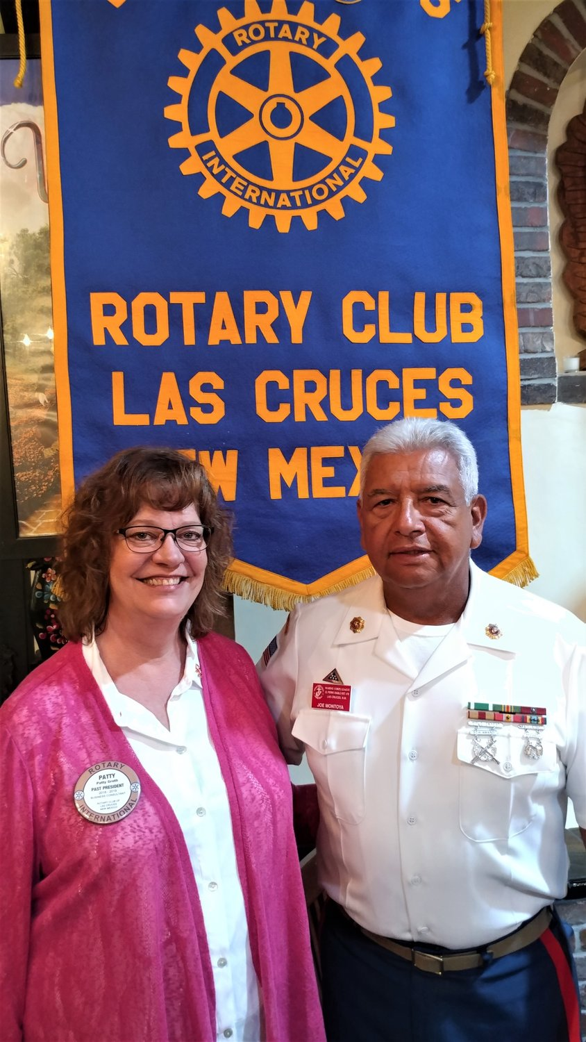 U.S. Marine Corps Reserves Toys for Tots of Doña Ana County Coordinator Patty Groth and Assistant Coordinator Joe Montoya, a retired Marine and the face of Toys for Tots, at the Oct. 2 meeting of the Las Cruces Rotary Club.