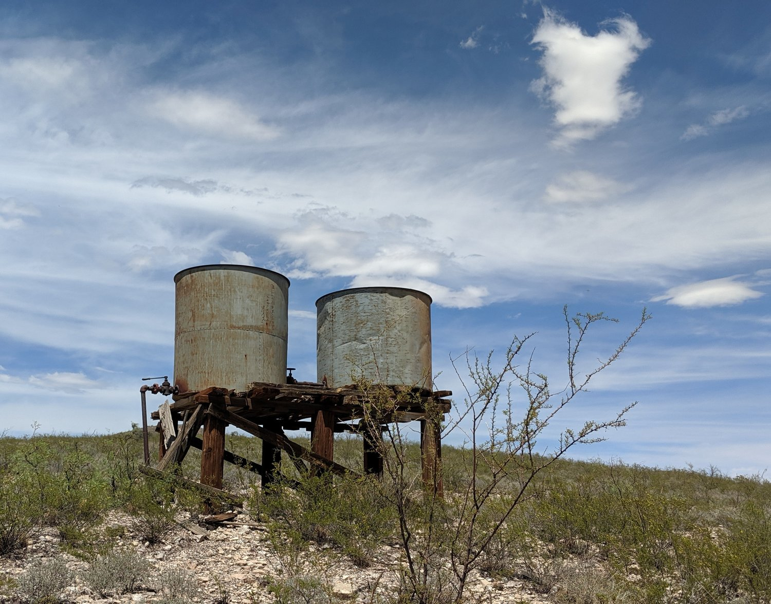 A couple of water towers mark where a railroad once served the thriving mining town of Lake Valley.