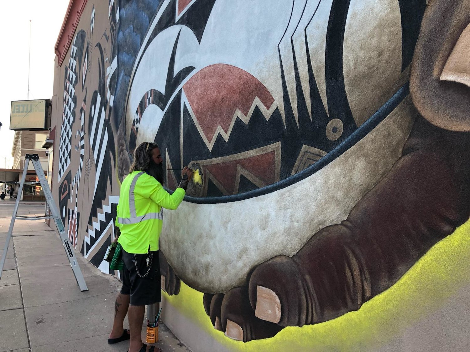 Jesse Kriegel works on his biggest project yet, a large, wide mural depicting the spirit of the Mimbres.