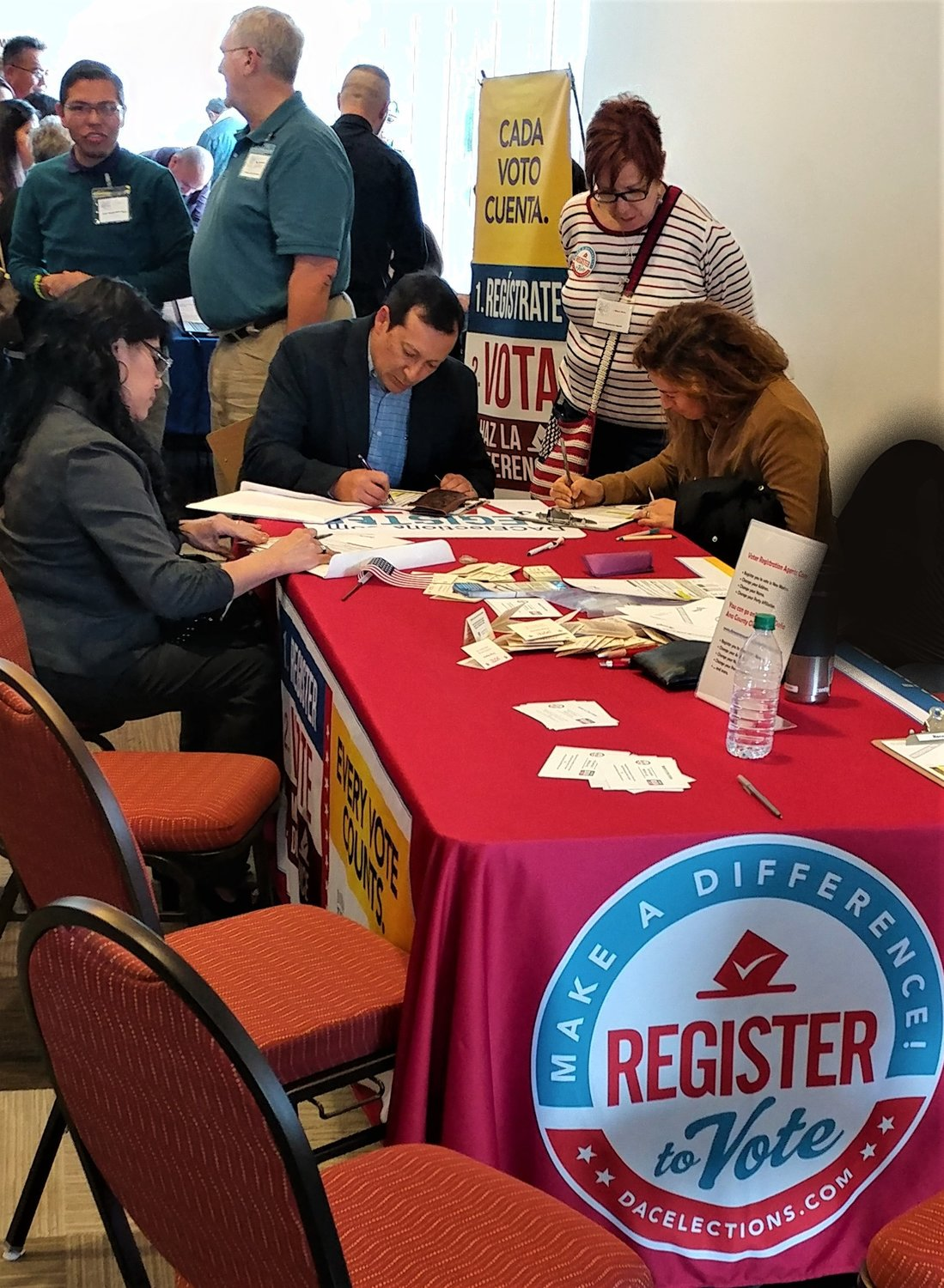 New American citizens could register to vote in the hallway outside the ballroom at Las Cruces Convention Center where they were sworn in.