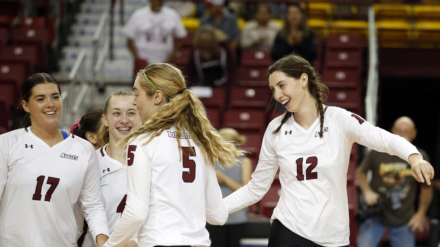 Krysten Garrison (17), Cat Kelly (4) Brigette Lowe (5) and Megan Hart (12) and their teammates have plenty to cheer in a dominating 25-3 season that saw NMSU go undefeated in the Western Athletic Conference. The Aggies open the conference tournament in a 6 p.m. Friday, Nov. 22, semifinal at Orem, Utah.