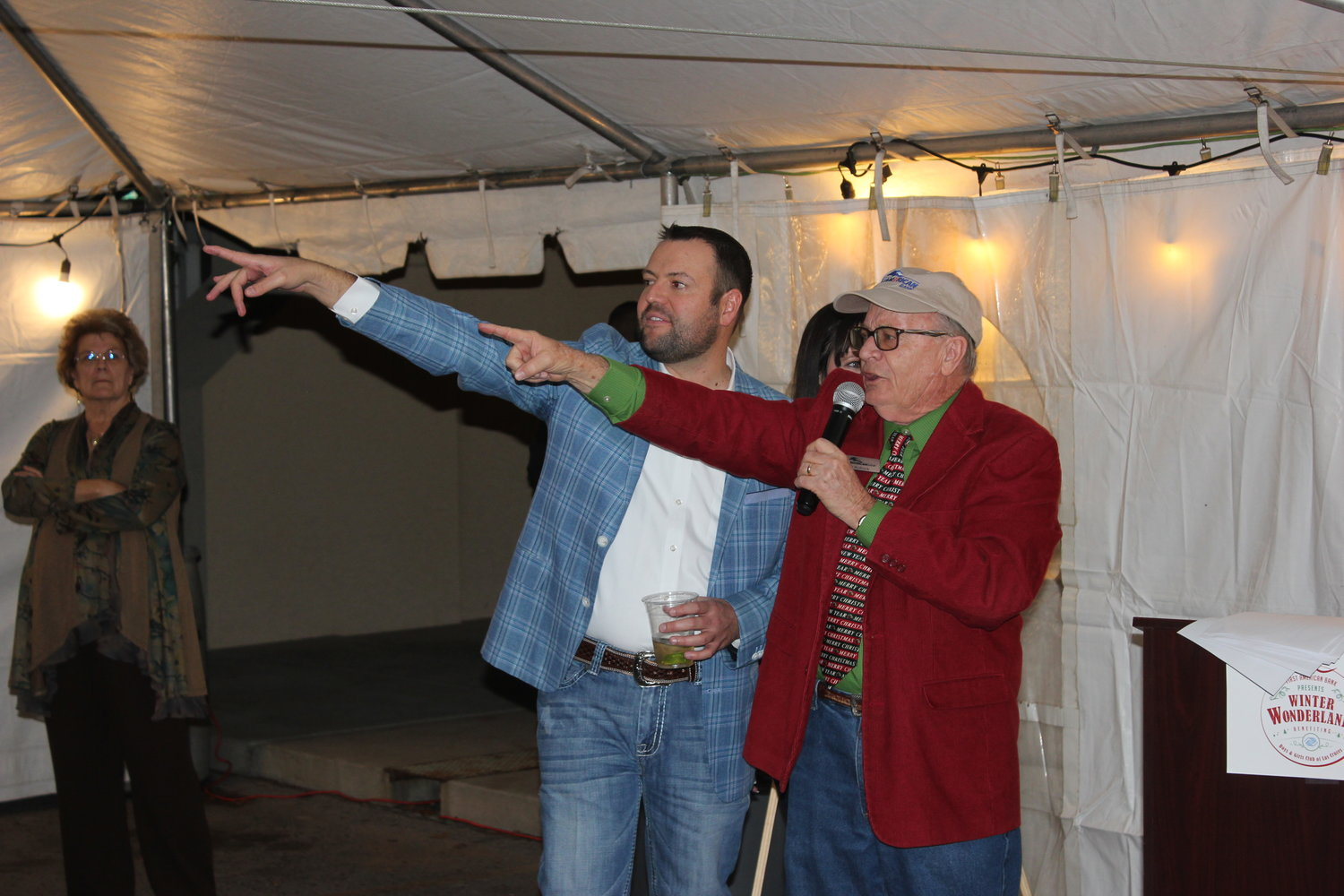Las Cruces Boys and Girls Club board chair Kevin Merhege and auctioneer Joe Bullock of First American Bank identify bids in the Nov. 22 Christmas tree auction to benefit the Las Cruces Boys and Girls Club.