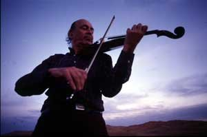 Violinist Jack Glatzer plays at the Silver City Public Library on Dec. 6.